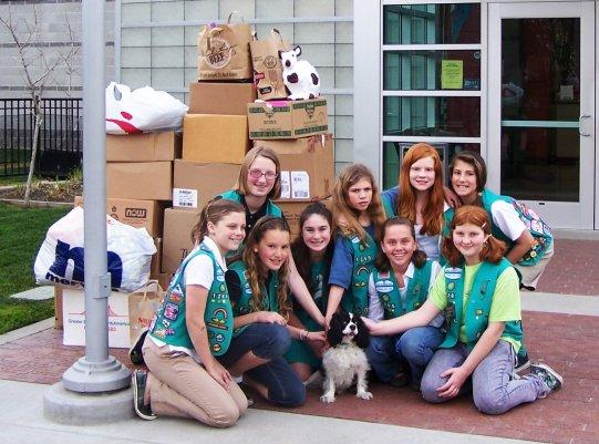Girl Scouts dropping off donations